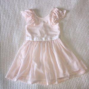 Light pink little girls flowy dress with sequins